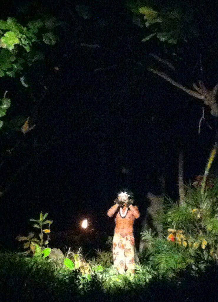Traditional blowing of the conch at Hawaiian luau in Kauai