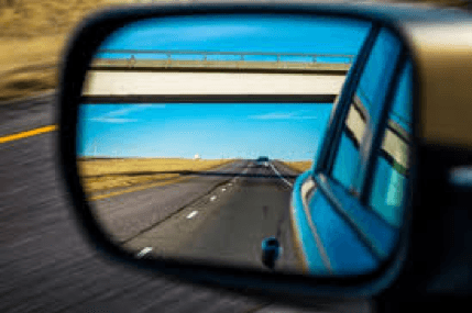 Side_Mirror_of_Car_with_Road_Reflection